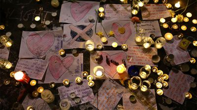 Messages and tributes left by members of the public at the Place de la Bourse, Brussels. (AAP)