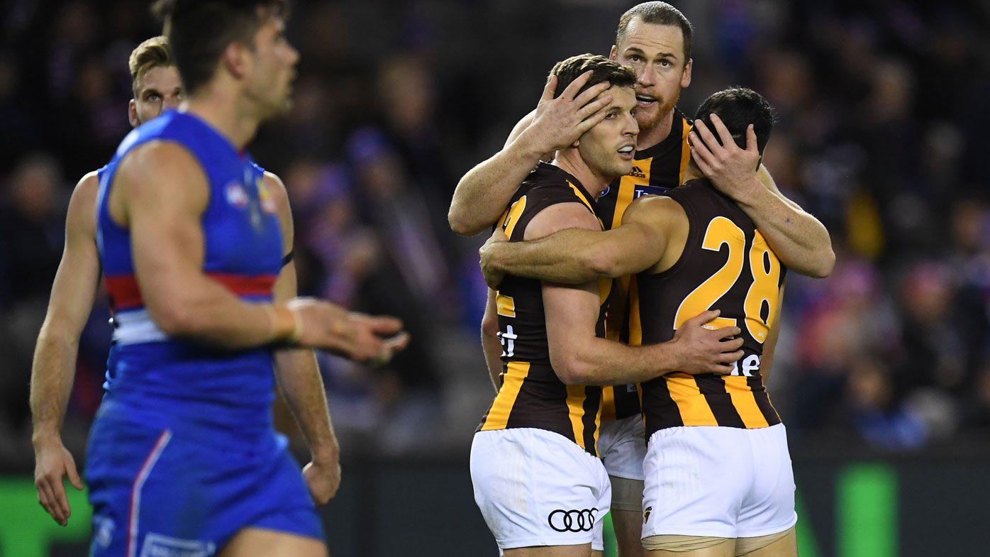 McEvoy injury sours big Hawks win in AFL