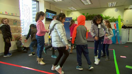 The program provides dynamic childcare inside the workplace. (9NEWS)