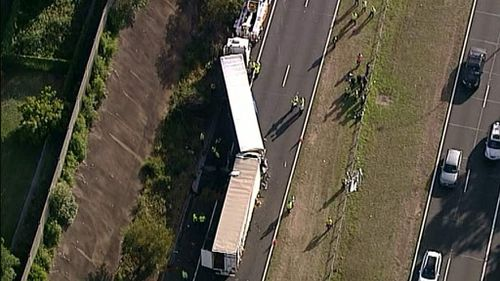 Sydney commuters are facing lengthy delays following a two-truck smash on the M2. (9NEWS)