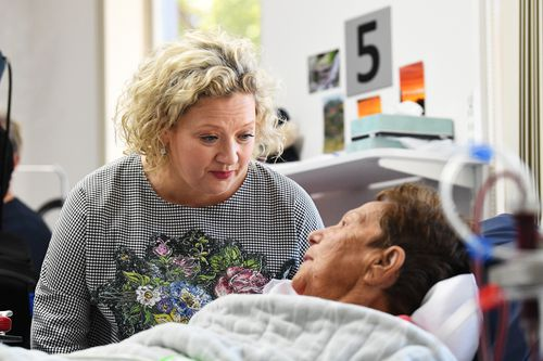 Health Minister Jill Hennessy  spoke to a patient at the hospital.