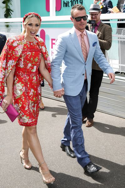 Bec Hewitt in Christa Lea with husband Lleyton in a Dom Bagnato suit.
