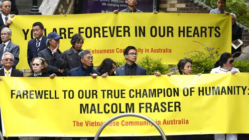 Mourners from the Vietnamese community pay their respects. (AAP)