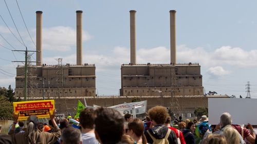 Clean Energy demonstrators march on Hazelwood Power Plant in Latrobe Valley, Victoria in October 2010. (AAP)