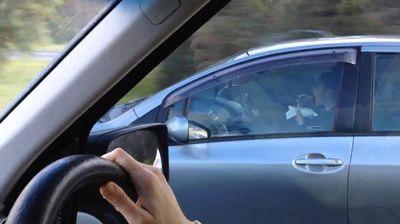 "<p>A Perth driver has been nabbed cruising down a busy street eating toast with both hands, leaving the steering wheel totally untouched.</p> <p> An irate passenger in a nearby car caught the careless motorist on camera and uploaded the footage to YouTube in early February. </p> <p> ""Stupid woman eating toast whilst doing 70 approaching roundabout. She doesn't want to get crumbs on her clothes though so she uses a plate and serviette. Very posh,"" the uploader commented. </p> <p> WA Police spokeswoman Ros Weatherall said drivers could get fined for eating while behind the wheel.</p> <p> ""Drivers not paying due care and attention while driving put themselves and other road users at risk, and may face charges under the Road Traffic Act,"" Ms Weatherall told ninemsn.</p> <p> As dangerous as that is, it doesn't have a patch on some other examples of dubious road safety from around the world. </p> <p> Click through for more. </p> <p> </p>"