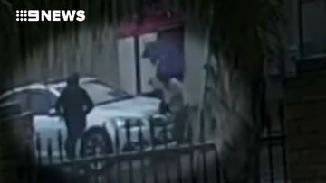 Woman fights off armed carjacker with umbrella