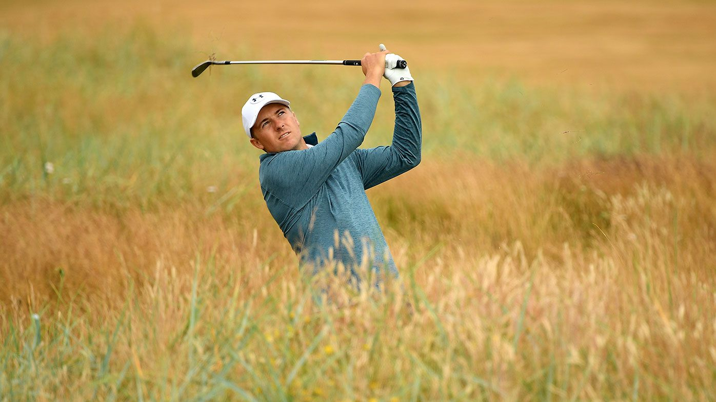 Jordan Spieth is lost in the rough during practice for the British Open