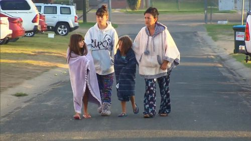 A devastated family returns home after being forced to evacuate. Picture: 9News
