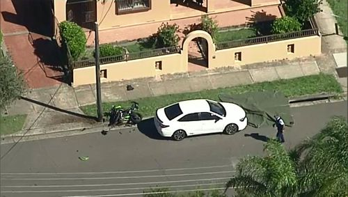Aerial vision of the crash shows the bike lying next to a telegraph pole surrounded by debris, while the man lay several metres away. Picture: 9NEWS.