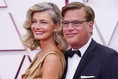 Paulina Porizkova, left, and Aaron Sorkin arrive at the Oscars on Sunday, April 25, 2021, at Union Station in Los Angeles. (AP Photo/Chris Pizzello, Pool)