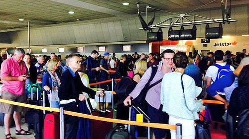 Jetstar passengers in Melbourne face a lengthy wait for their flights.