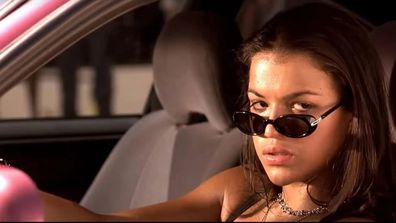 Michelle Rodriguez in the movie Fast and the Furious driving