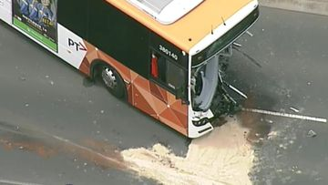 The bus has sustained significant damage.