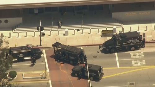 Armoured vehicles at the scene.