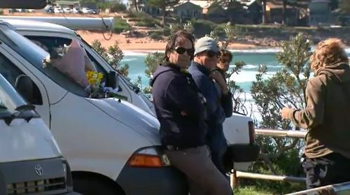 Residents today gathered at his vehicle to lay flowers and remember the popular local surfer, who has been described as 'iconic' in the community.
