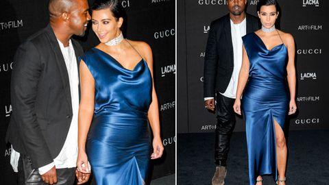 Baby bump? Kim K fuels pregnancy rumours with figure-hugging dress