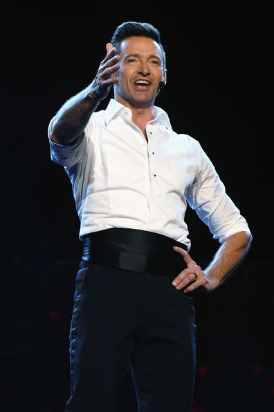 Hugh Jackman singing on stage world tour