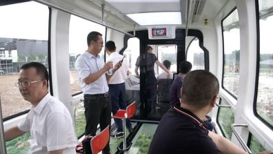 "Inside China's Zhongtang Air Railway, a sky train with a ""glass"" bottom"