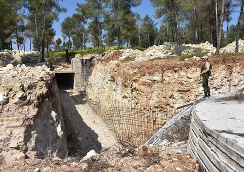 A soldier stands guard at a terrorist underground base with the capacity to host approximately a thousand people, discovered within the 'Operation Olive Branch' at a forest in the mountains in Afrin, Syria on April 13, 2018