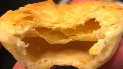 Man bites into empty meat pie