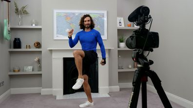 Joe Wicks, aka The Body Coach, teaches the UK's school children physical education live via YouTube on March 23, 2020 from his home in London, England