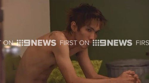 9NEWS crews found the accused in the bedroom of the Brisbane Airbnb property. (9NEWS)