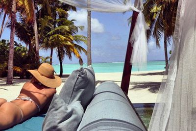 """Jennifer Hawkins' model/developer hubby Jake Wall has posted a throwback photo of his famous wife's rather famous behind.  """"Pass me a margarita I'm enjoying the view. #TB,"""" Jake wrote on Instagram with the snap, which appears to be from their Maldives holiday last year.  See more shots from their sexy vacay here."""