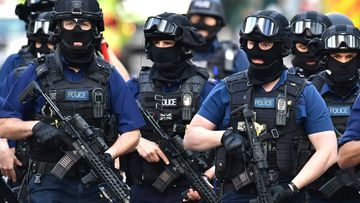 Armed police on St Thomas Street on June 4, 2017, near the scene of Saturday night's terrorist incident on London Bridge and at Borough Market. Several people were killed in the terror attack at the heart of London and dozens injured.