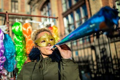 A reveller blows a paper trumpet celebrating New Year's Eve in Budapest, Hungary.