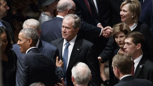 Former President George W Bush was amongst those at the memorial, as was Hilary and Bill Clinton