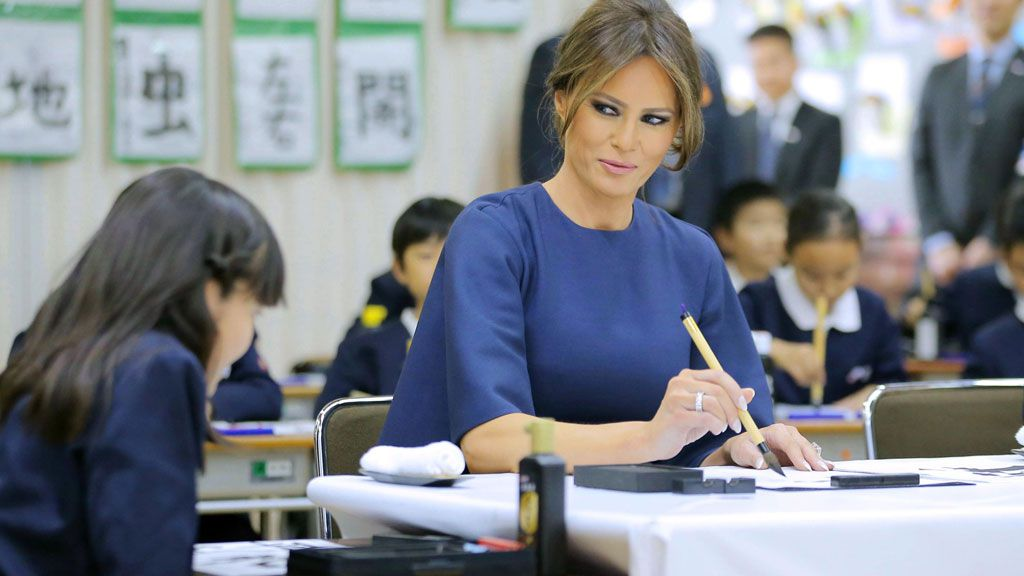 United States first lady learns calligraphy at Japanese primary school