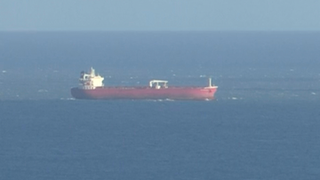 In this image taken from SKY video, shows a tanker at sea, as filmed from land on Sunday October 25, 2020. British police are investigating an undisclosed incident aboard an oil tanker in the English Channel. The incident reportedly took place aboard the Libyan-registered oil tanker Nave Andromeda south of Sandown on Isle of Wight, according to Isle of Wight Radio. (SKY News via AP)