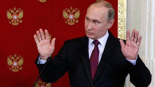 Putin warns of chemical weapons 'provocations' to frame Assad