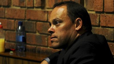February 21, 2013: South African police name a top detective to the case after it emerges that the officer initially assigned to it, Hilton Botha, faces attempted murder charges. (AAP)