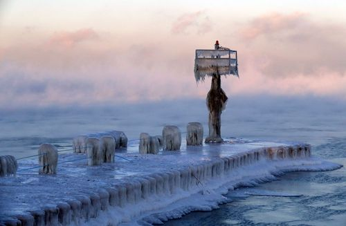 A harbor light is covered by snow and ice on Lake Michigan.