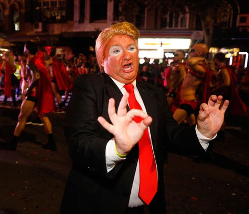 A marcher donned fake tan and a wig for this Donald Trump impersonation. (AAP)