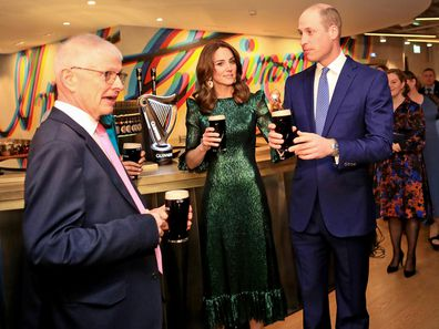 Prince William, Duke of Cambridge and Catherine, Duchess of Cambridge hold a pint of Guinness as they visit the Guinness Storehouses Gravity Bar