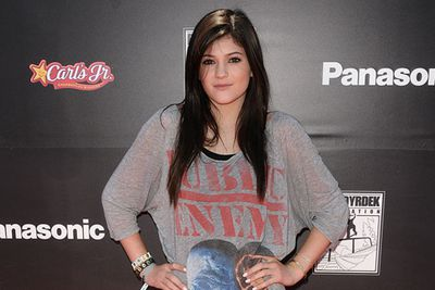 Working the pose, pout and Public Enemy band shirt… Kylie's style starts to evolve.