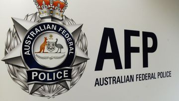 An Australian Federal Police officer has been charged with sex offences against a young person.