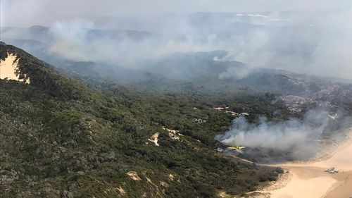 Fraser Island residents told to prepare to leave as bushfire edges closer