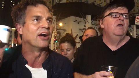 Mark Ruffalo and Olivia Wilde join Michael Moore's anti-Trump rally in New York