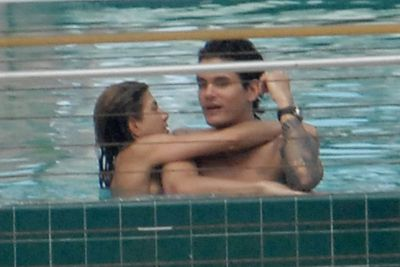 Jen and ex John Mayer on holiday in 2008. Yes, she IS wearing a bikini (it's flesh-pink!).