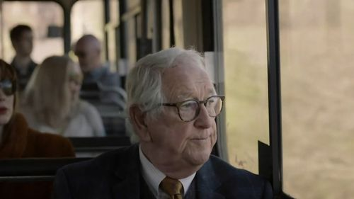 The video shows an elderly man travelling alone.