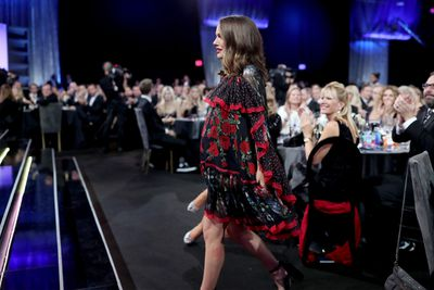<p>Caped crusader: Walking to accept the award for 'Best Actress' for 'Jackie' wearing a caped, floral Alexander McQueen dress, at The 22nd Annual Critics' Choice Awards.</p>