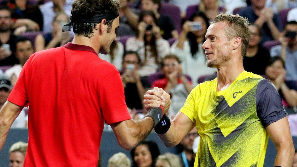 Roger Federer (L) and Lleyton Hewitt. (Getty-file)