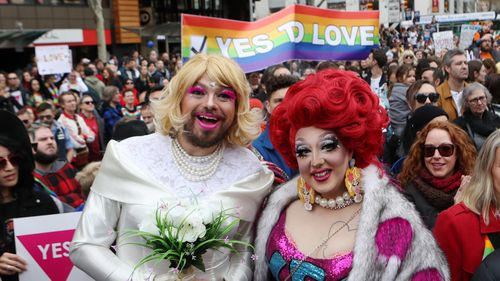 Supporters join in the marriage equality rally in Melbourne. Saturday, August 26, 2017. (AAP)