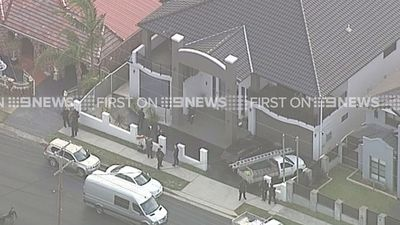 Police also raided a home at Merrylands.
