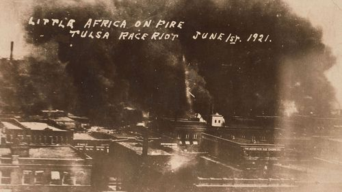 The Greenwood District burns during the mob violence on June 1, 1921. (Image gift of Cassandra P. Johnson Smith)