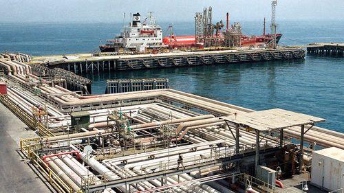 Oil pipelines snake through the port area of the Aramco facility at Ras Tannura, Saudi Arabia
