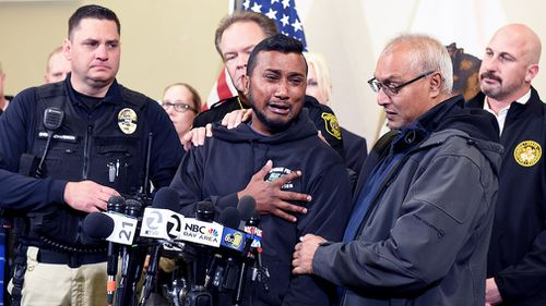 Sheriff Christianson called for stricter laws at a news conference as Cpl Singh's brother wept beside him.
